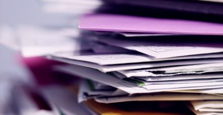 A messy pile of paperwork