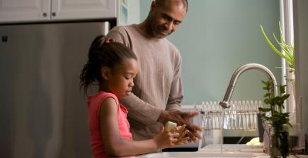 Father and child washing hands